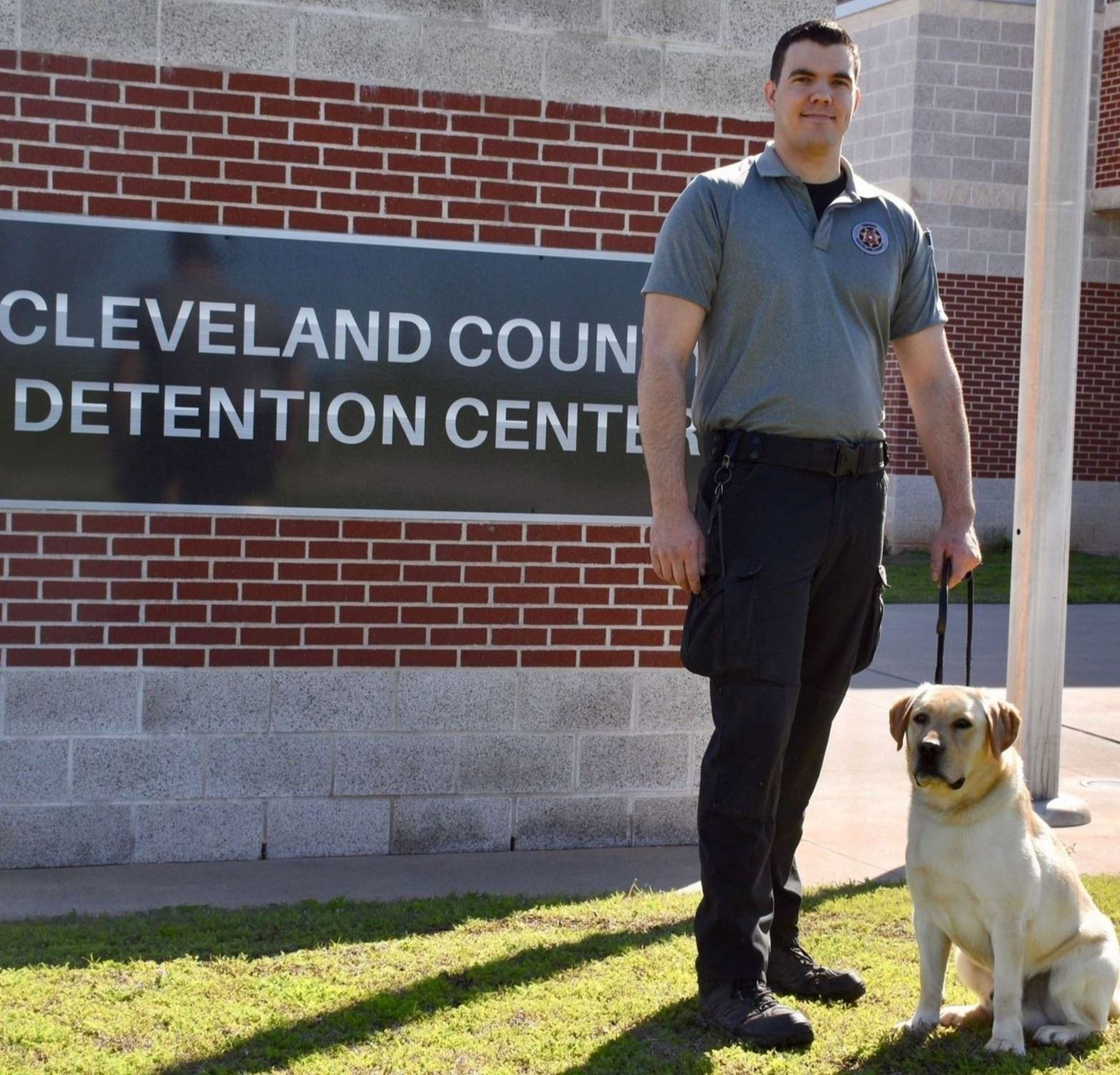 Detention K-9 Handler Ben Hoffman and K-9 Dolar